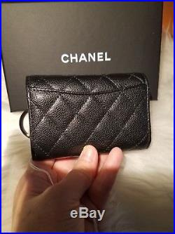 Authentic CHANEL 4 ring key holder. Black caviar with light gold hardware
