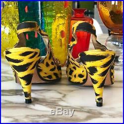 GIANNI VERSACE shoes Animal print with gold-tone Greek Key chain slingback pumps