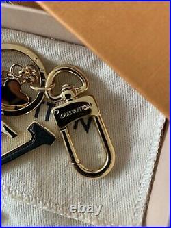 NIB Auth Louis Vuitton Metal Rubber LV Key Chain Holder / Bag Charm / Accessory