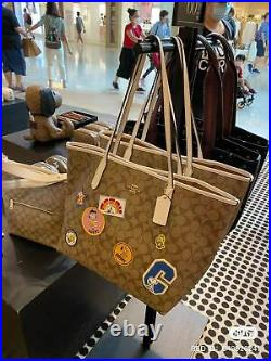 NWT Coach X Peanuts City Tote In Signature Canvas Or Snoopy Key Chain